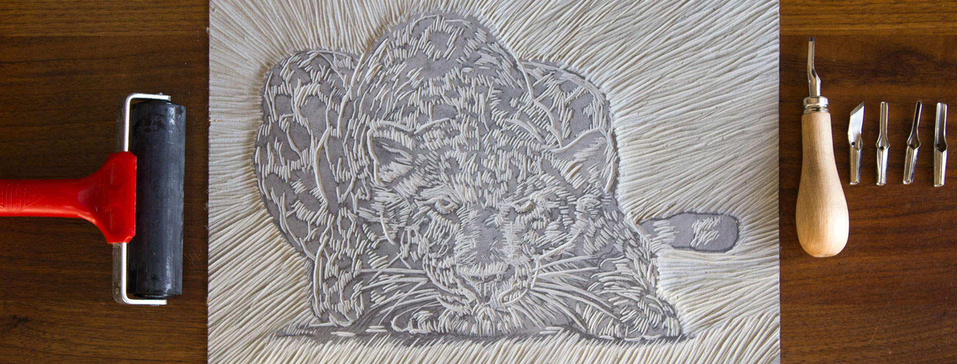Linocut of a leopard for a wine label design