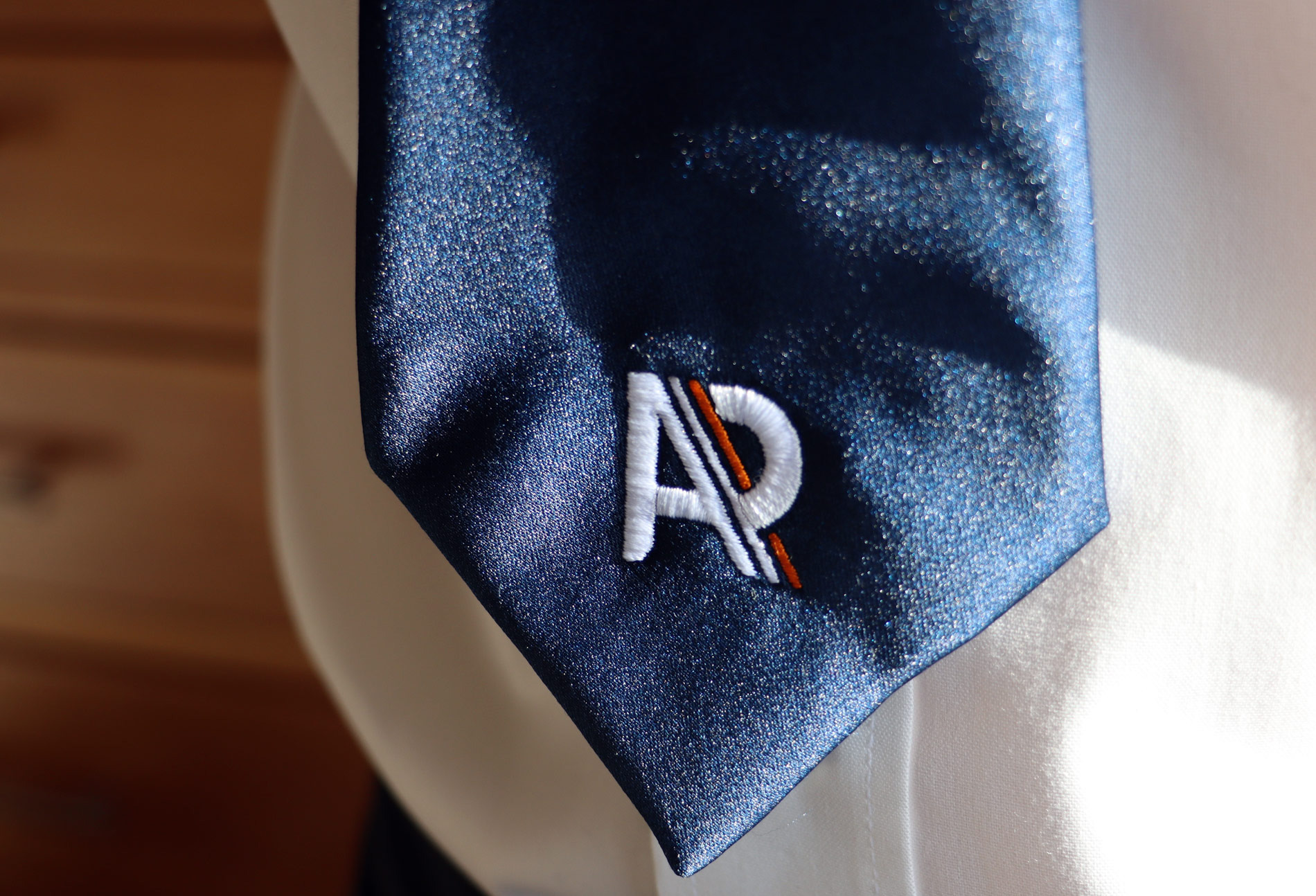 Embroidered logo onto a branded tie